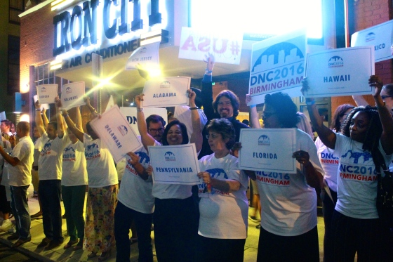 Supporters gather outside of Iron City to welcome the DNC delegates